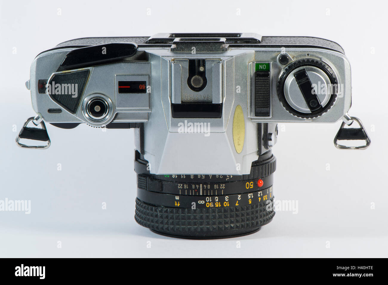 Classic 1980's Minolta X-300 - 35mm film, single lens reflex camera with a 50mm Minolta prime lens, against - Stock Image