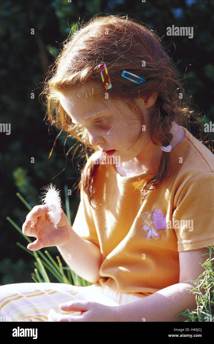 Girls, bird's feather, look, seriously, half portrait, side view, summers, child, red-haired, plaits, freckles, - Stock Image