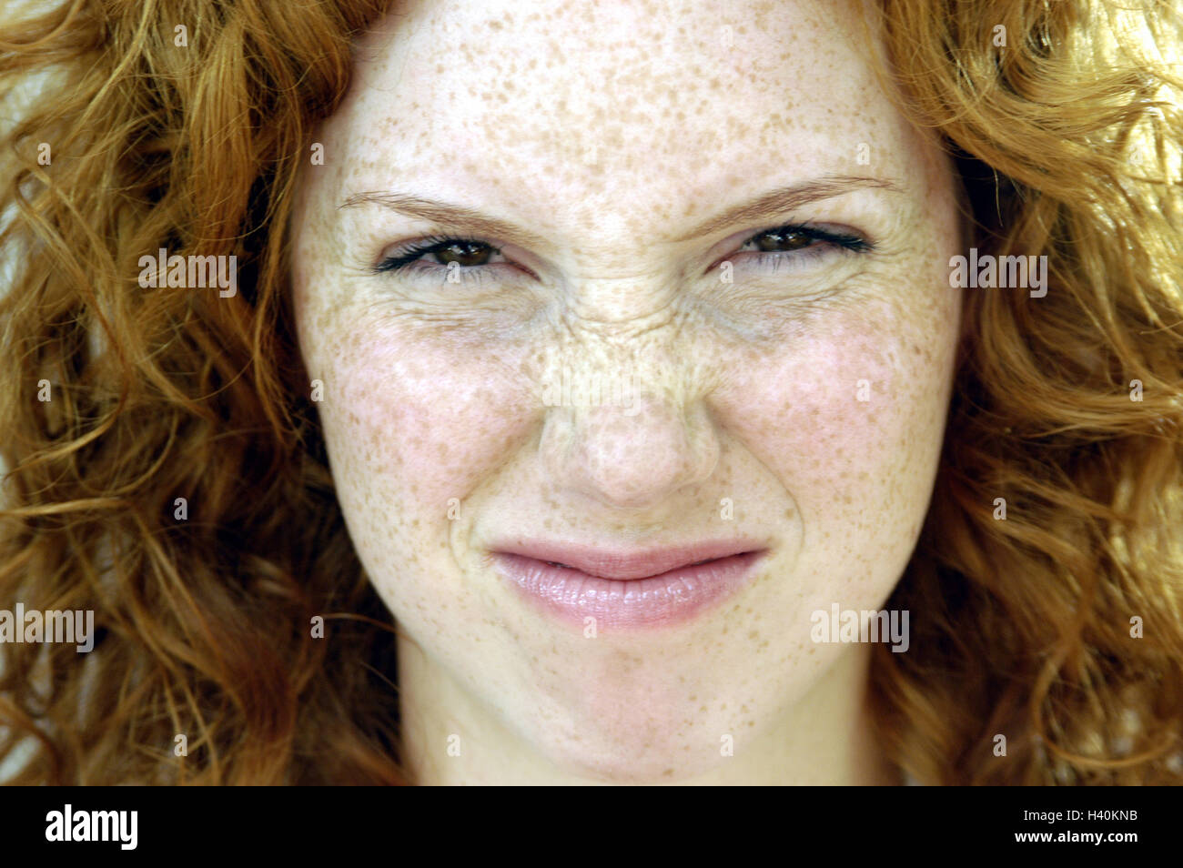 Woman, facial play, nose bodies, portrait, women's portrait, redheads, red-haired, locks, look, expression, - Stock Image