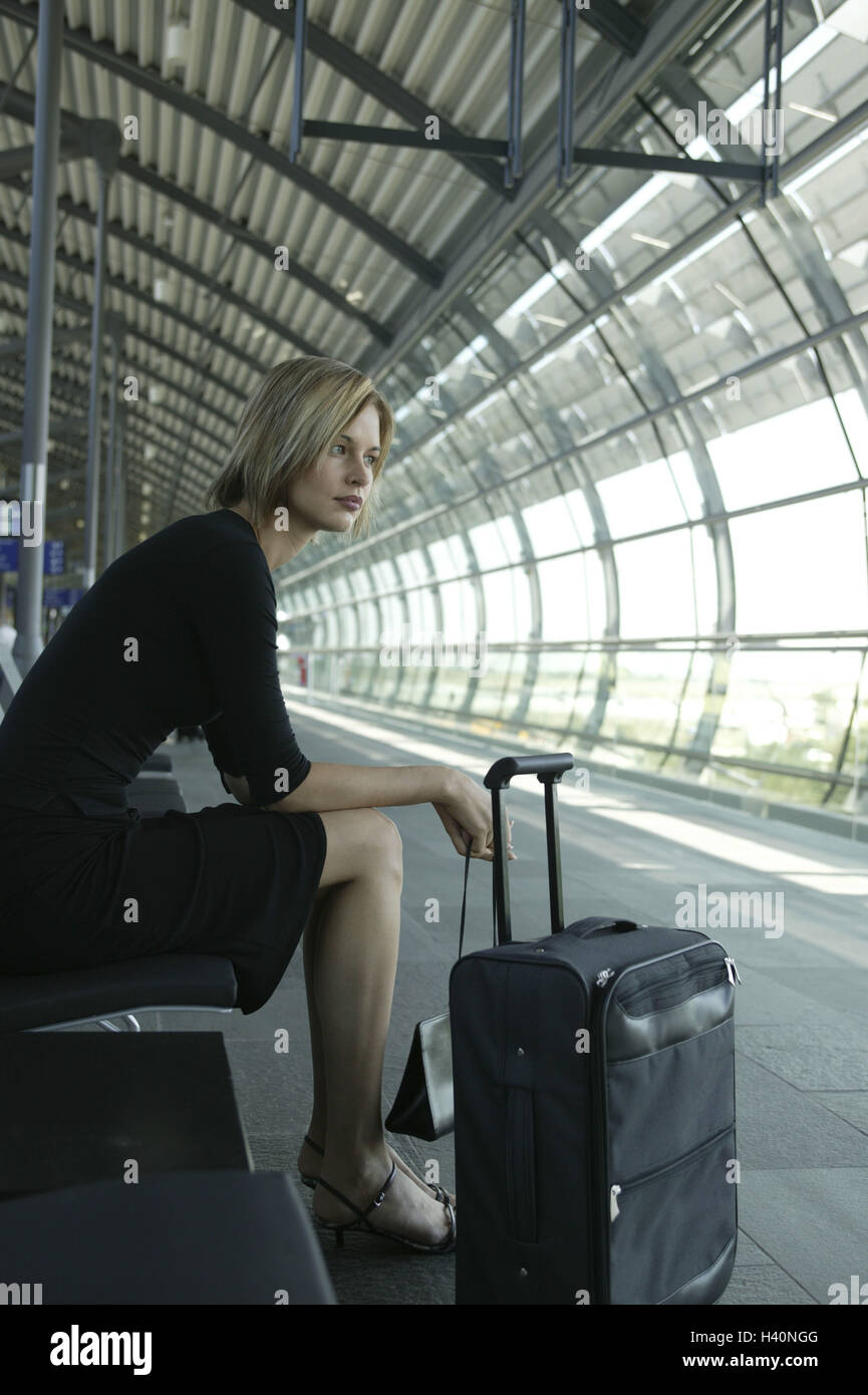 Airport, hall, woman, sit, wait, boredom, travellers, 20-30 years, young, blond, airport terminal, waiting room, Stock Photo