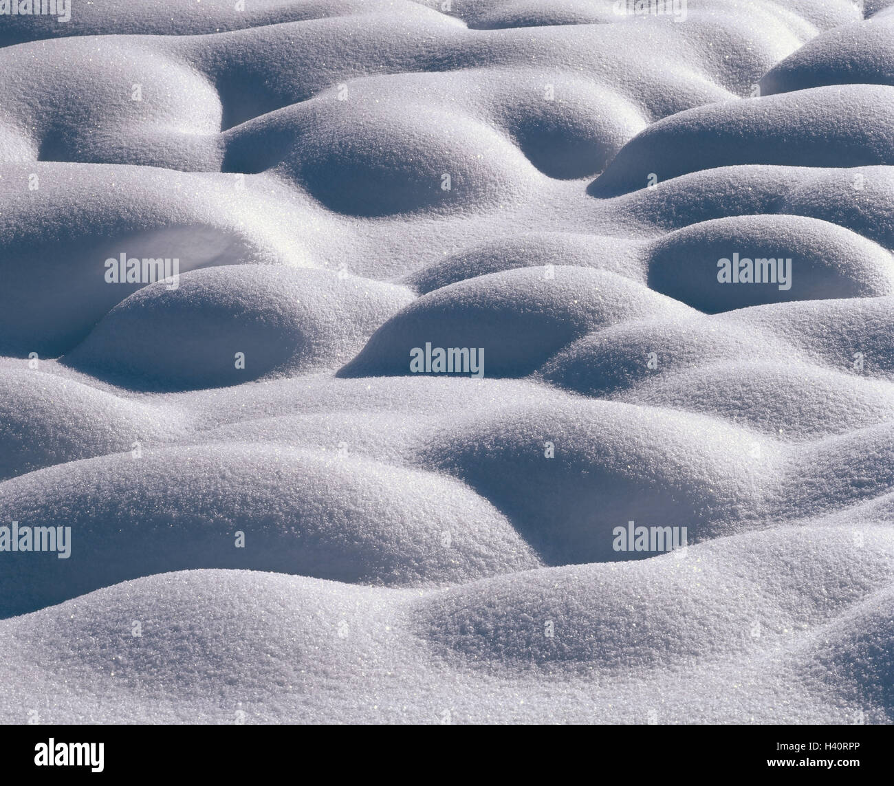 Snow surface, hilly, season, winter, snow, fresh snowfall, powder snow, snow-covered, hill, waves, unevenly, unevennesses, - Stock Image