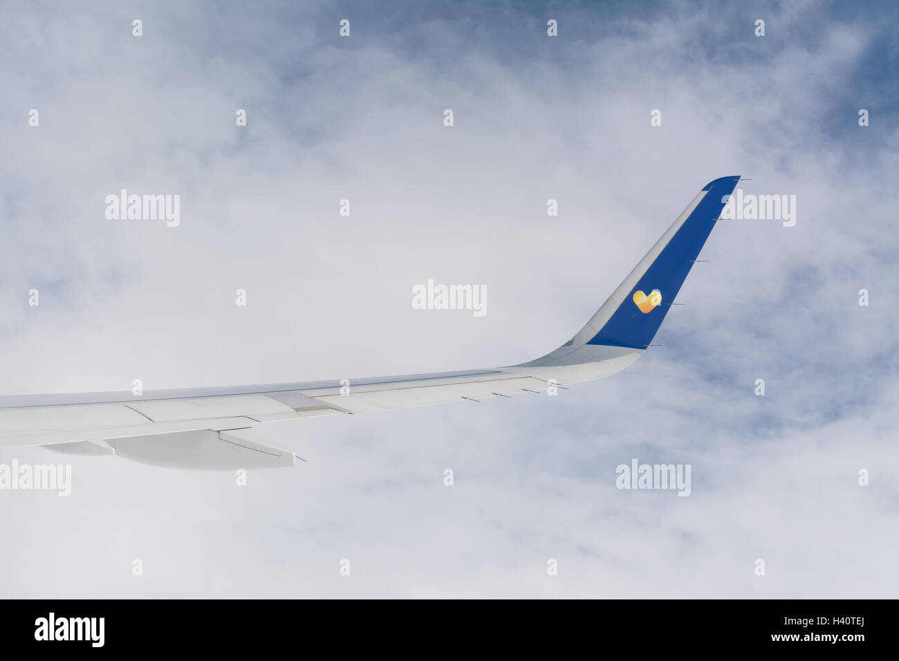 Thomas Cook plane wing with heart logo - Stock Image