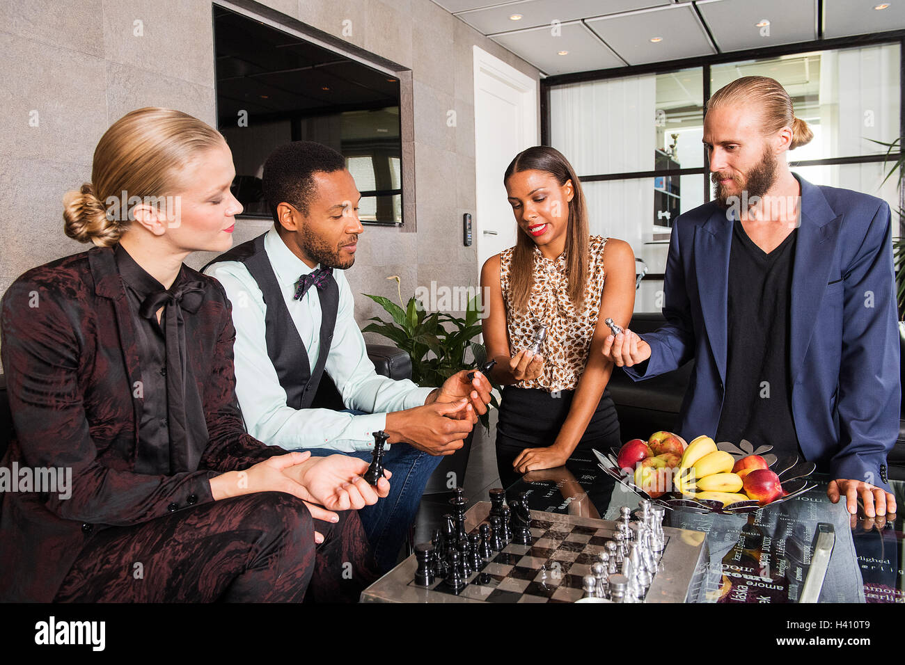 Strategic business meeting with chess play - Stock Image