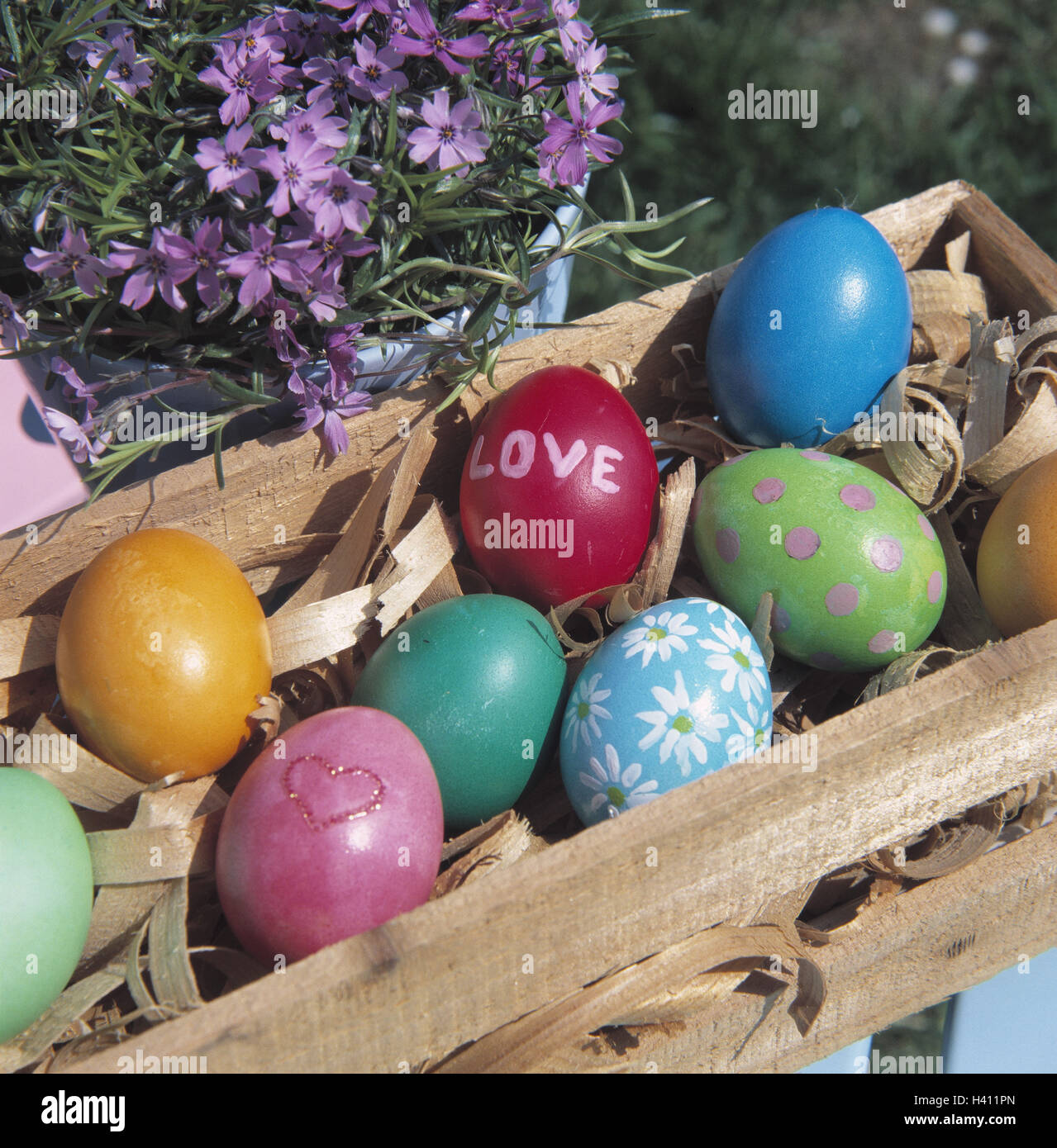 Meadow, garden chair, detail, wooden box, Easter eggs, Easter, Easter feast, season, spring, spring, traditions, - Stock Image