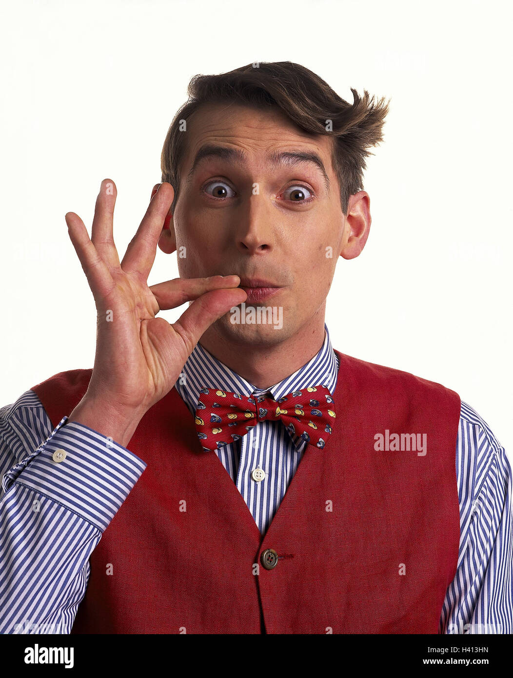 Man, young, page apex, mop hair, shirt, waistcoat, fly, gesture, perfectly, o.k., portrait, Men, studio, cut out, - Stock Image