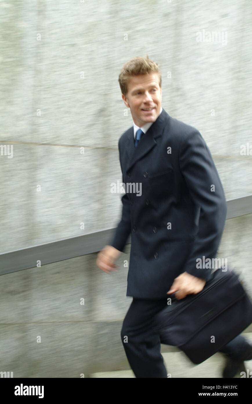 Pedestrian subway, businessman, briefcase, stairs, run, go down, blur town, underpass, steps, man, manager, 30-40 Stock Photo