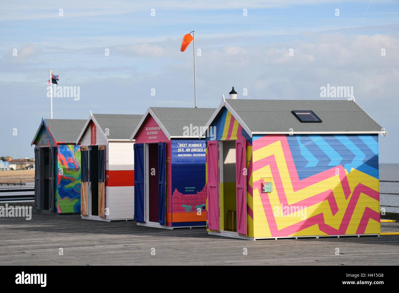 Brightly coloured beach huts on Southend pier as part of the Estuary Festival, Essex Sep 2016 Stock Photo