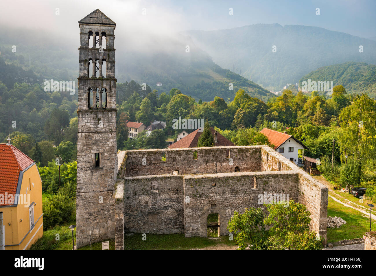 Ruins of St Mary Church and St Luke bell tower, morning haze, in Jajce, Central Bosnia Canton, Bosnia and Herzegovina - Stock Image