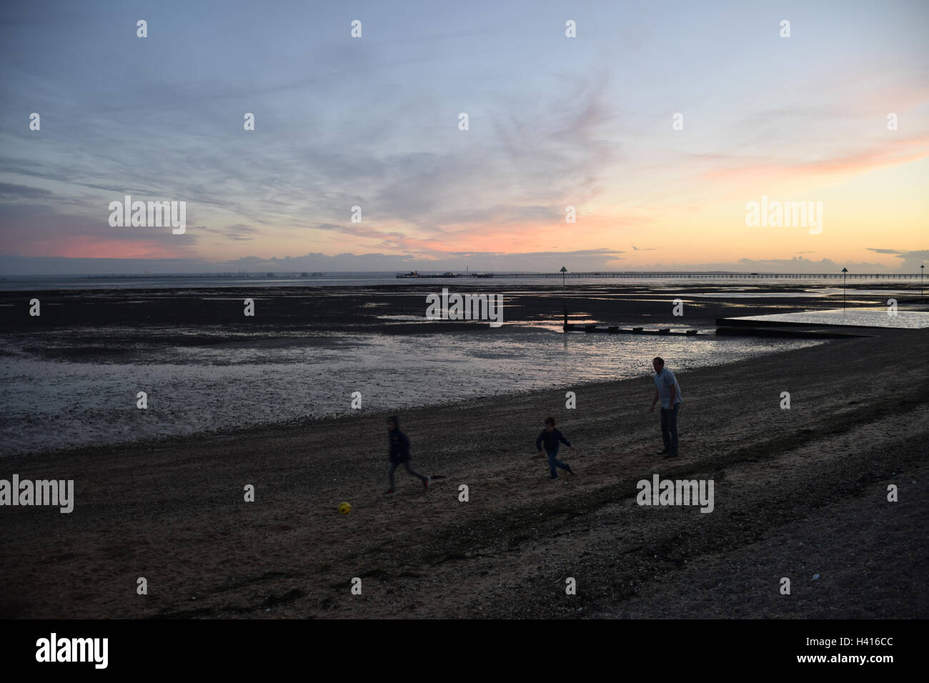 Southend-on-Sea beach at sunset, Essex Stock Photo