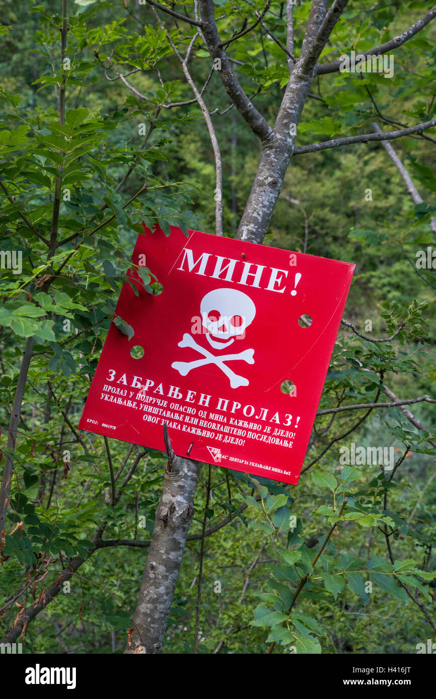 Mines warning sign near Tjentiste, Sutjeska National Park, Dinaric Alps, Republika Srpska, Bosnia and Herzegovina - Stock Image