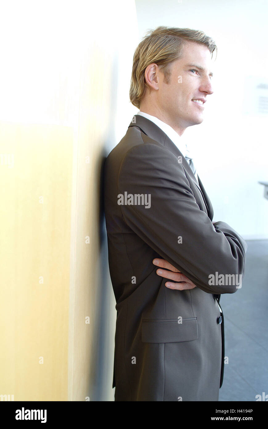 Man, young, contently, half portrait, side view, business, office, businessman, Manager, office worker, blond, blue - Stock Image