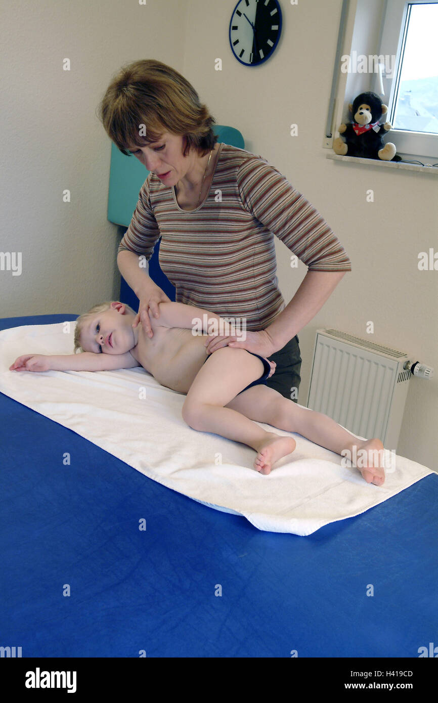 Physiotherapy, boy, couch, therapeutist, treatment, practise, medicine, disease, ailment, health, therapy, application, - Stock Image