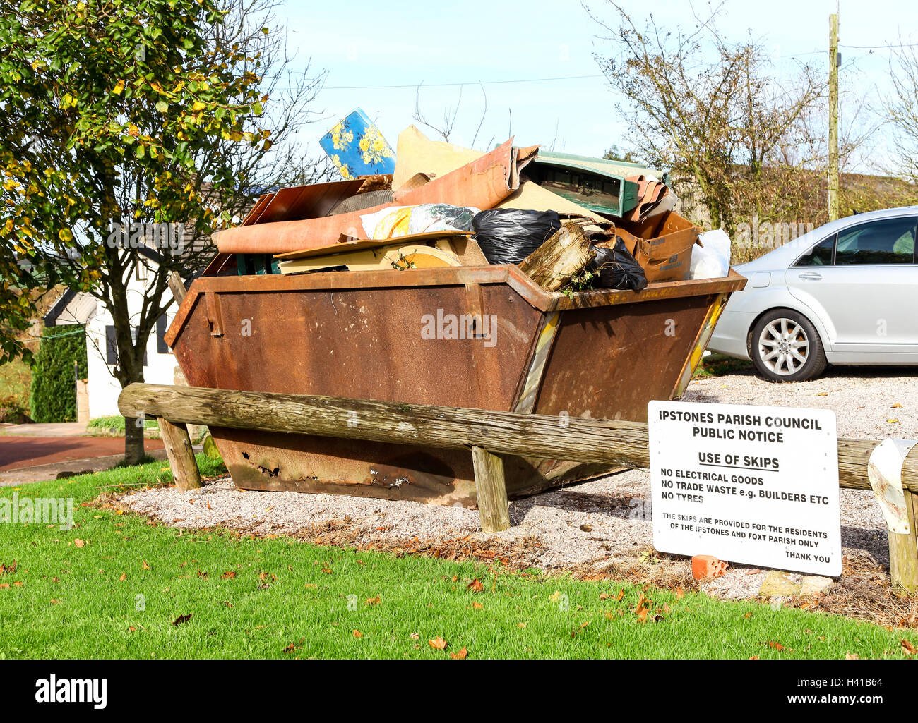 A communal skip for waste materials for villagers in the village of Foxt Staffordshire Moorlands England UK - Stock Image