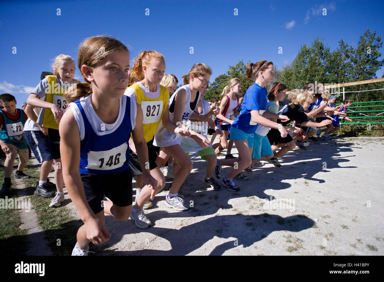 runners at starting line at track meet - Stock Image