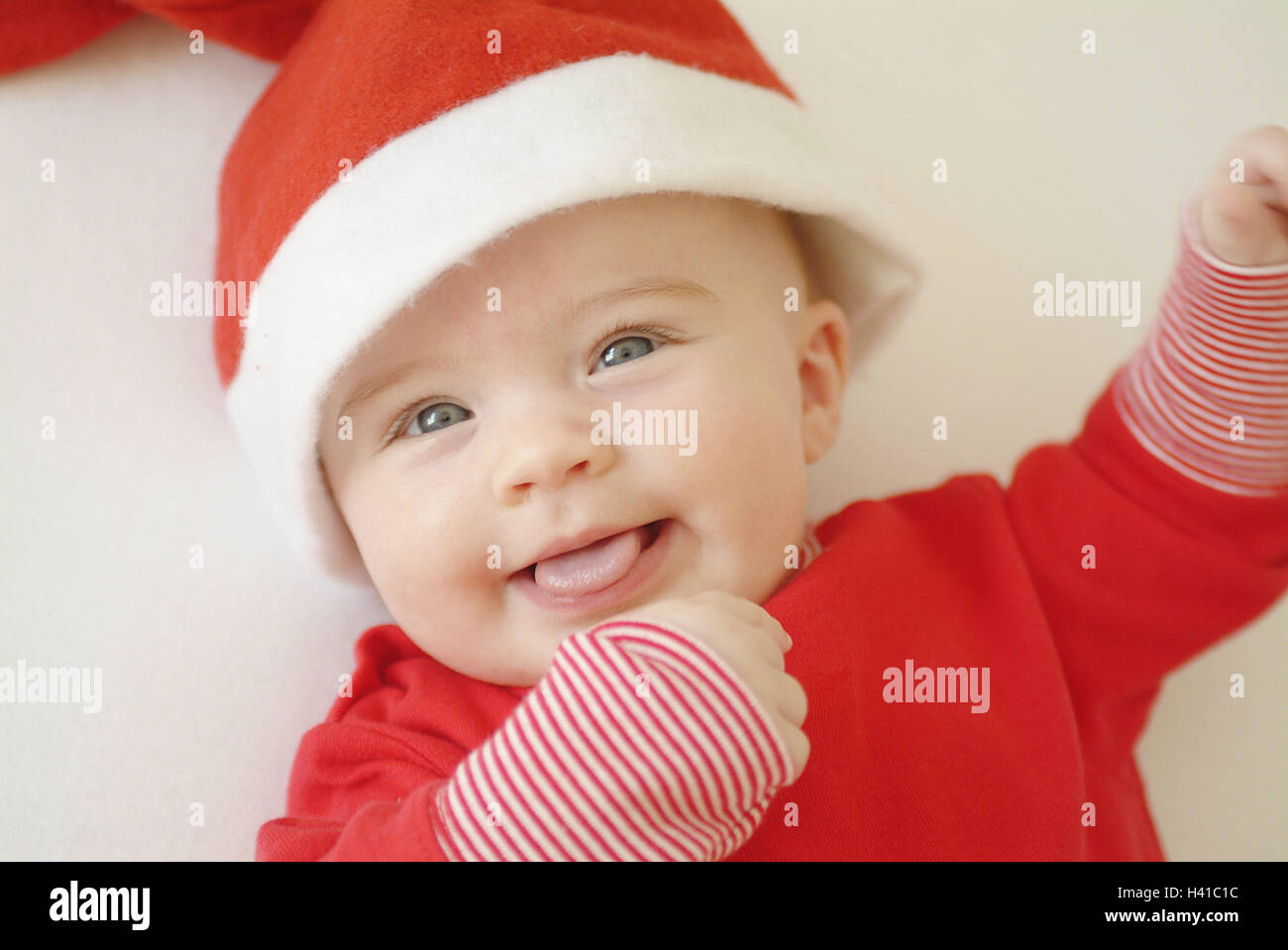 bd34dd8cc Baby, smile, lie, Christmas cap, portrait, from above, child Stock ...