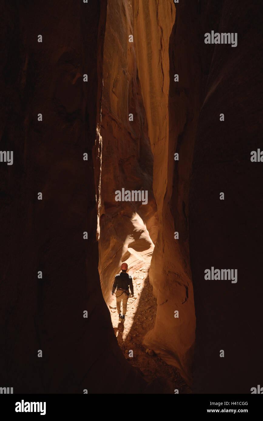 Canyoneering through a slot canyon in Southern Utah Stock Photo