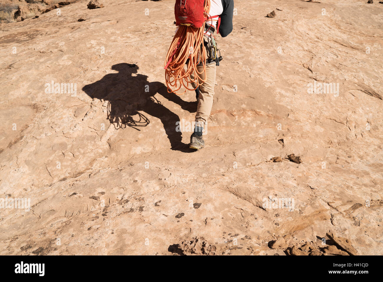 A man prepares to rappel down a canyon in southern Utah - Stock Image