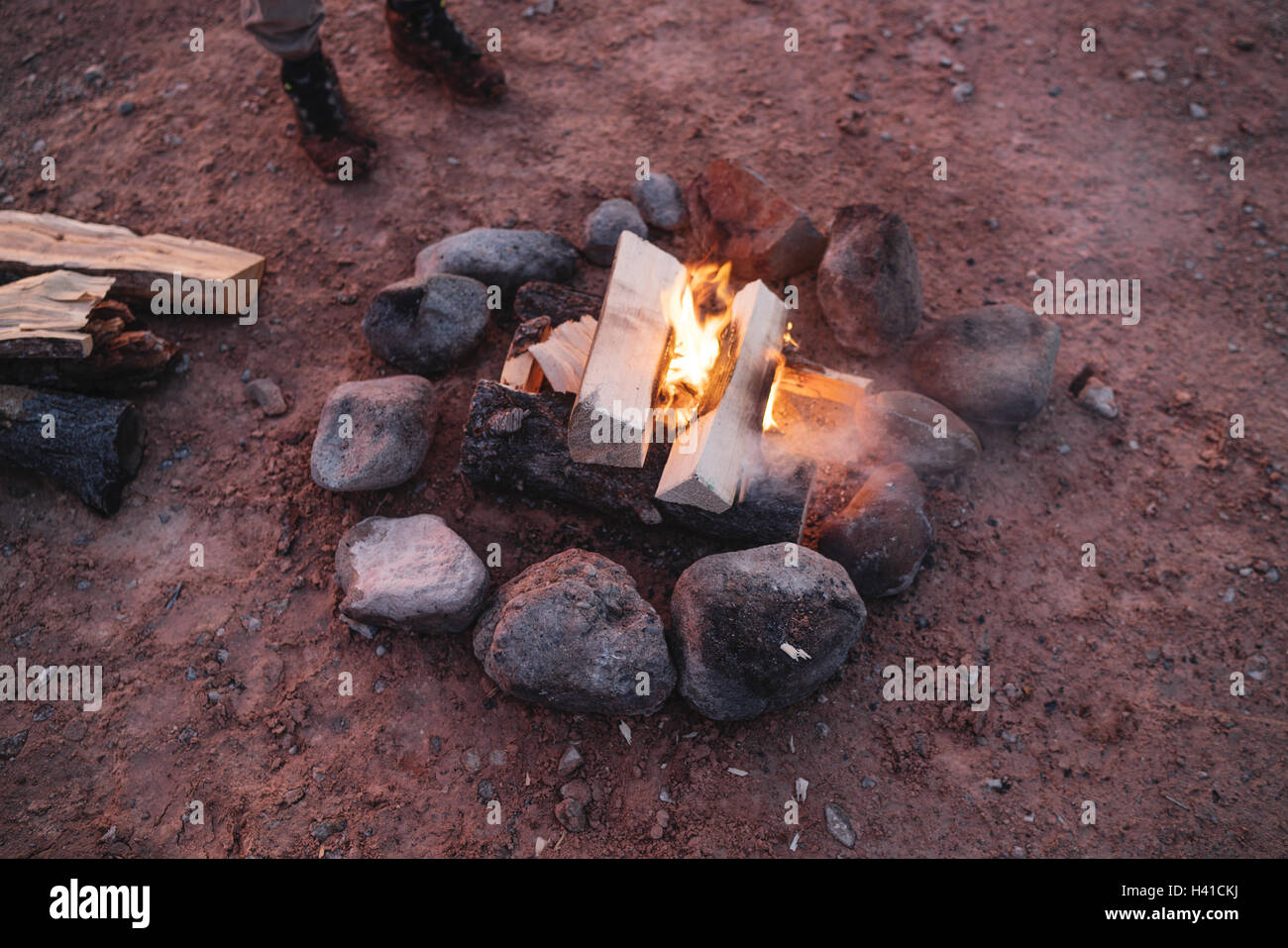 Burning firewood at a campsite in southern Utah - Stock Image