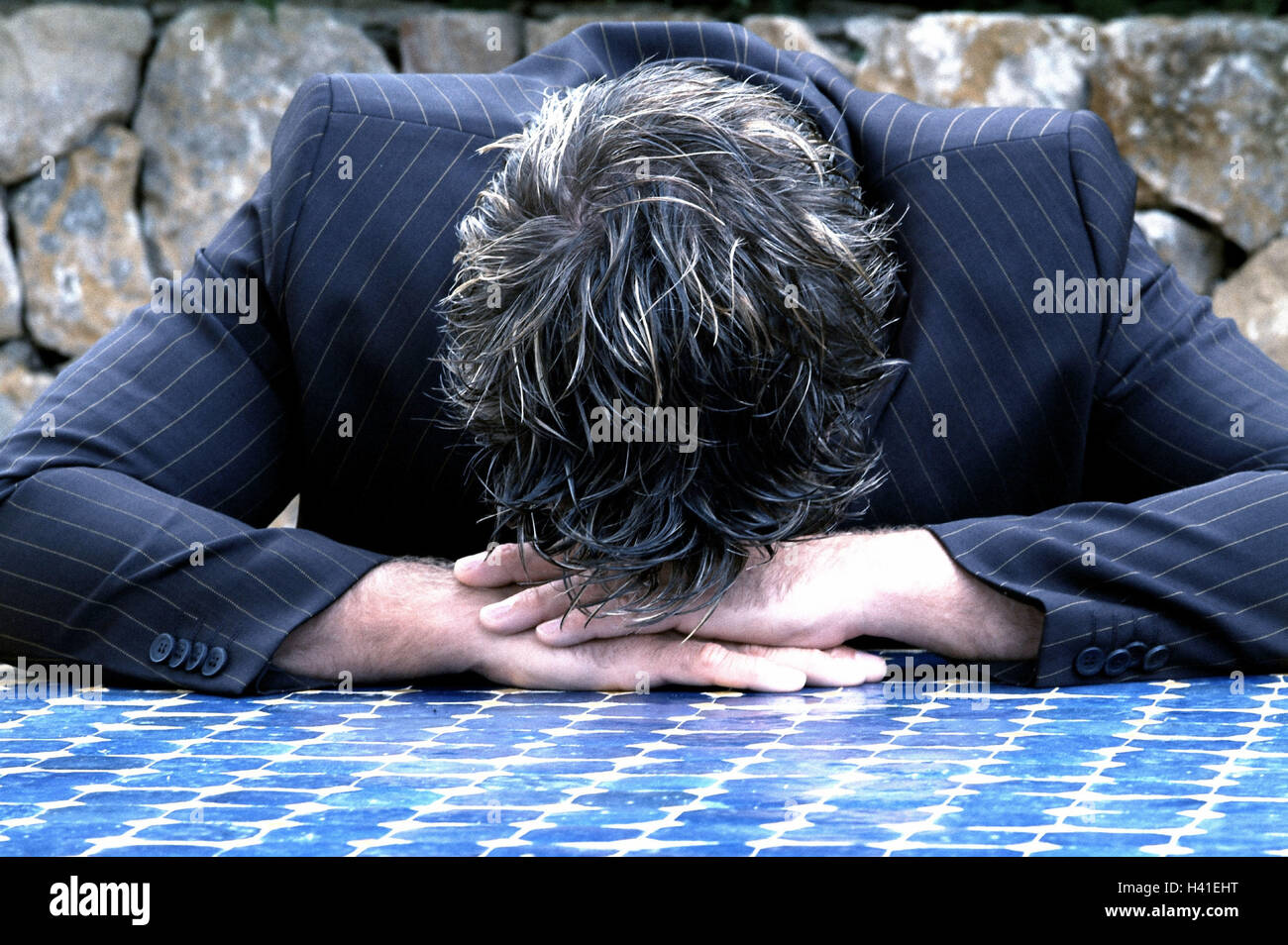 Man, suit, mosaic table plate,  Rested head, knocked down,  depress Emotion, businessman, failure, problem, worries, - Stock Image