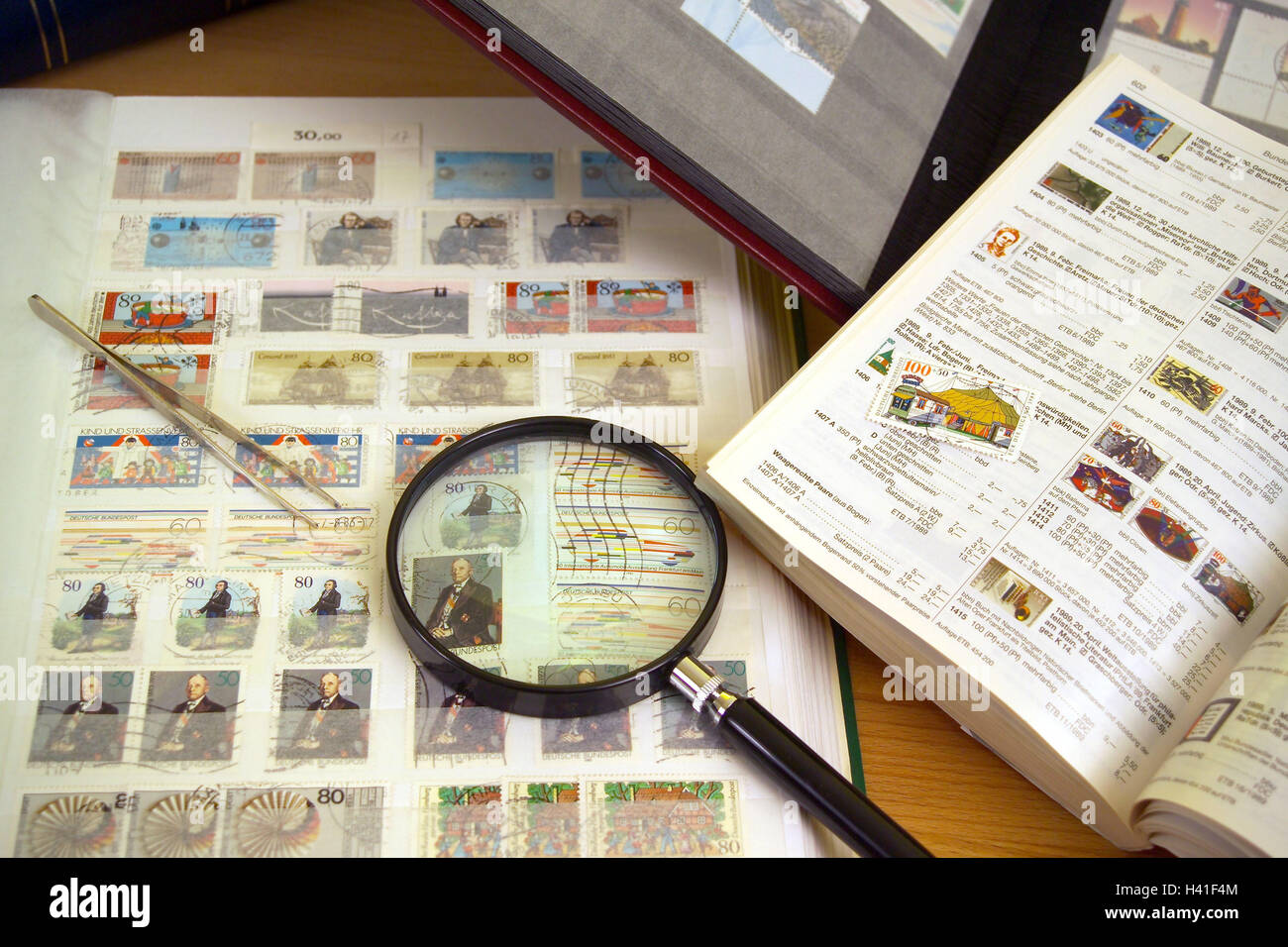 Loupe, tweezers, stamp, album, curled, leisure time, hobby, collection, stamp collection, collect, philatelic collecting, - Stock Image