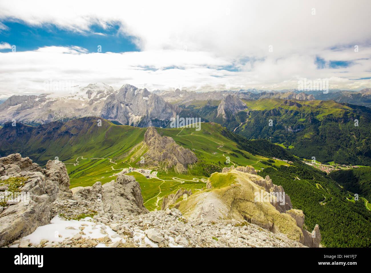 Pordoi pass mountain road and Marmolada mountain range seen from the Sass Pordoi plateau in Dolomites, Italy, Europe - Stock Image