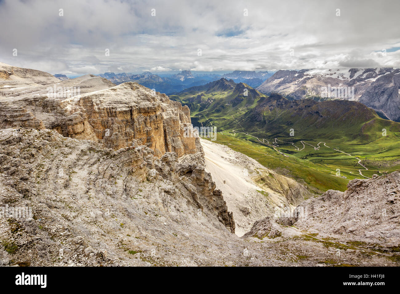 Pordoi pass mountain road valley and Piz Boe seen from the Sass Pordoi plateau in Dolomites, Italy, Europe - Stock Image