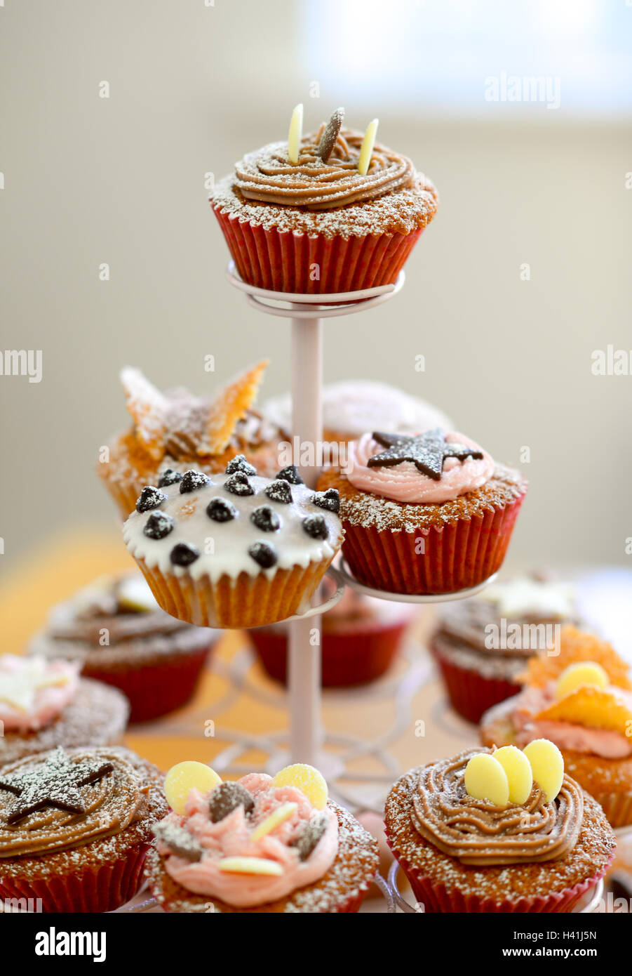 Cupcakes on a tiered stand. - Stock Image