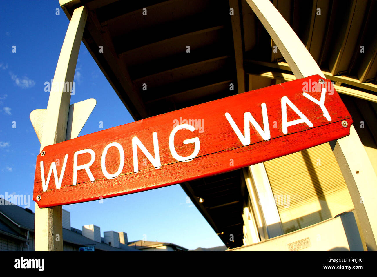 Building, detail, sign, 'Wrong Way' road sign, sign, red, label, 'wrong way', direction the traffic, - Stock Image