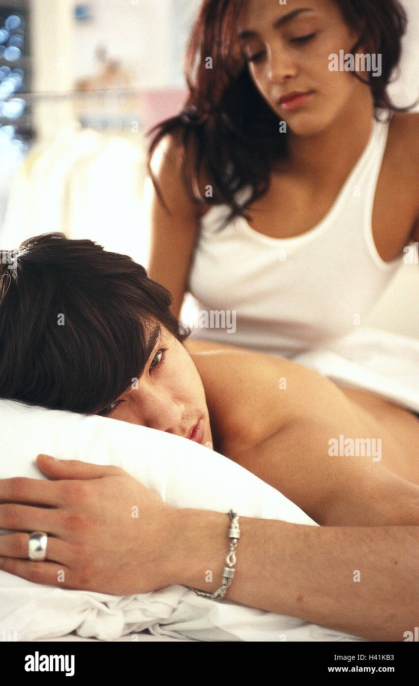 Bed, couple, disappointment, frustration, model released, partnership, conflict, discontent, seriously, thoughtful, - Stock Image