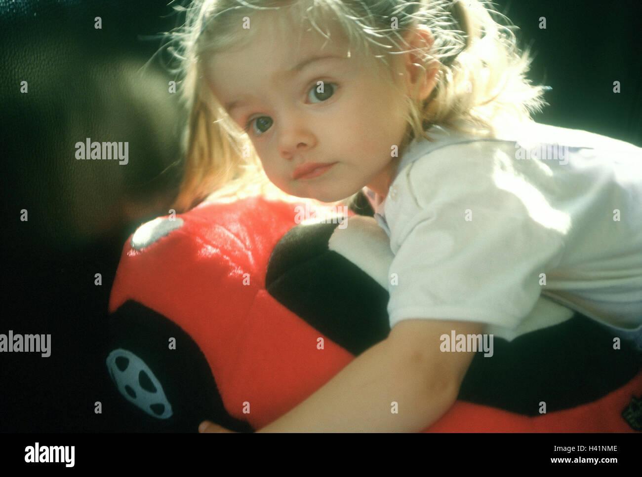 Toddler, girls, Kuschelkissen, lies   indoors, at home, child, childhood, pillows, child pillows, toy, Kissenauto, Stock Photo