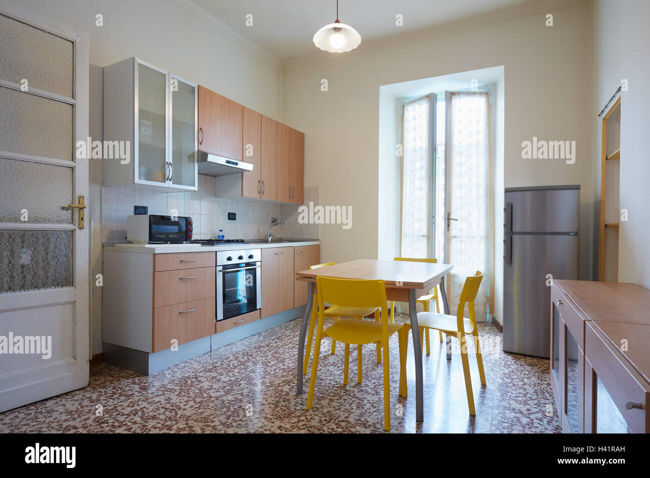 Simple kitchen interior in normal apartment - Stock Image