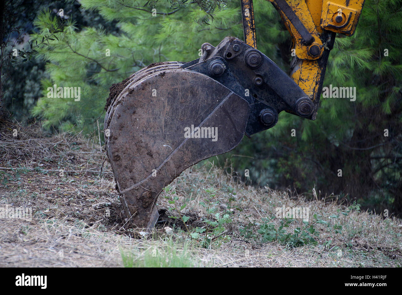 Digger excavating soil - Stock Image