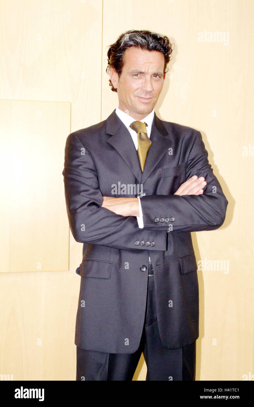 Office, manager, stand, smile, self-confidently, bank, cashier, banker, man, 34 years, businessman, clothes, suit, - Stock Image