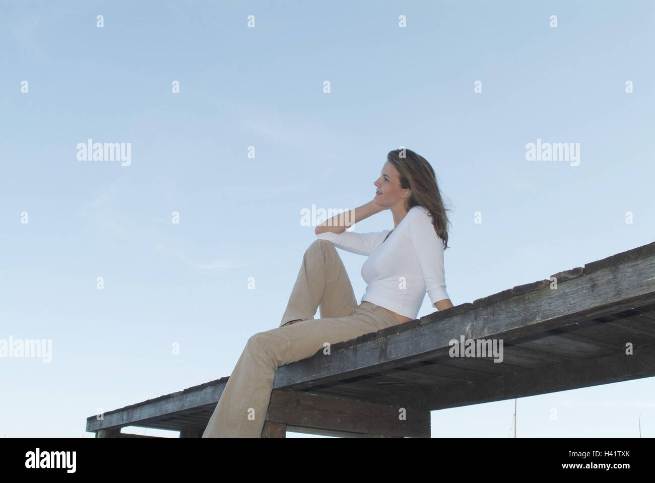 Wooden jetty, woman, young, sit, take it easy, enjoy Ti5, bridge, 28 years, leisure time, rest, loneliness, think, - Stock Image