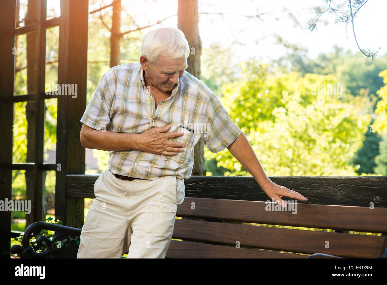 Senior man has heartache. - Stock Image