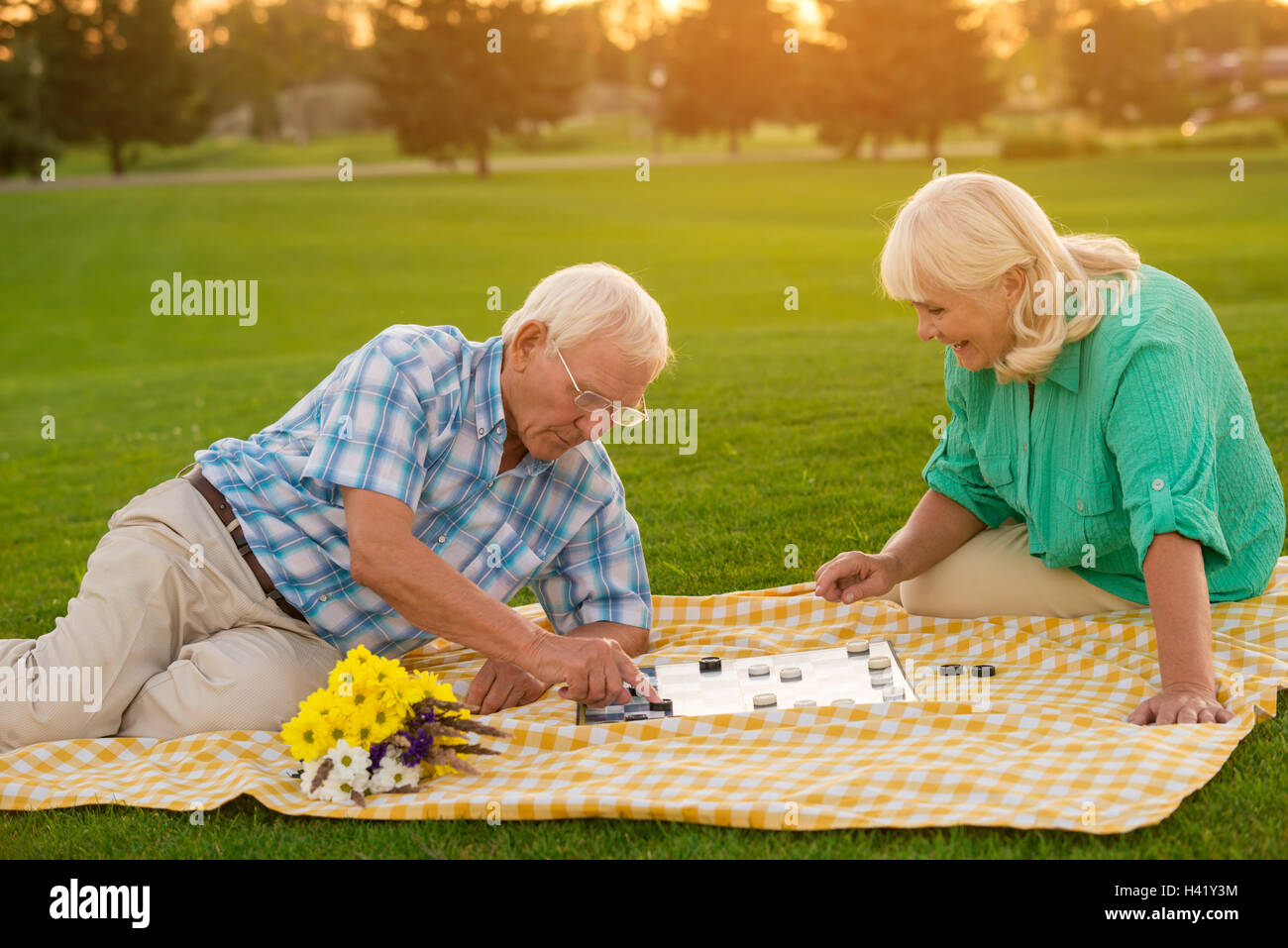 Senior couple plays checkers. Stock Photo