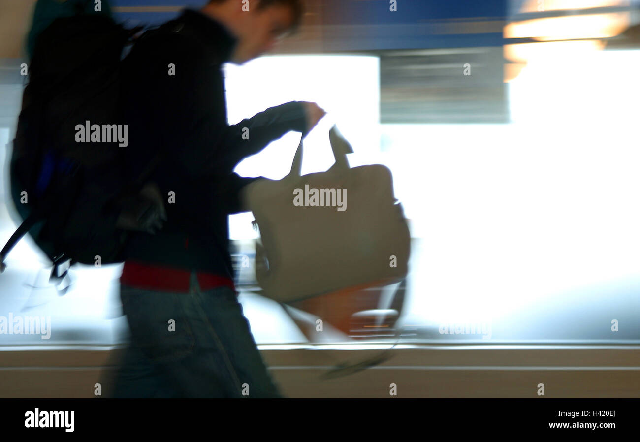 Airport, terminal, traveller, at the side, pouch, carry, blur, person, man, air passenger, passenger, rice, journey - Stock Image