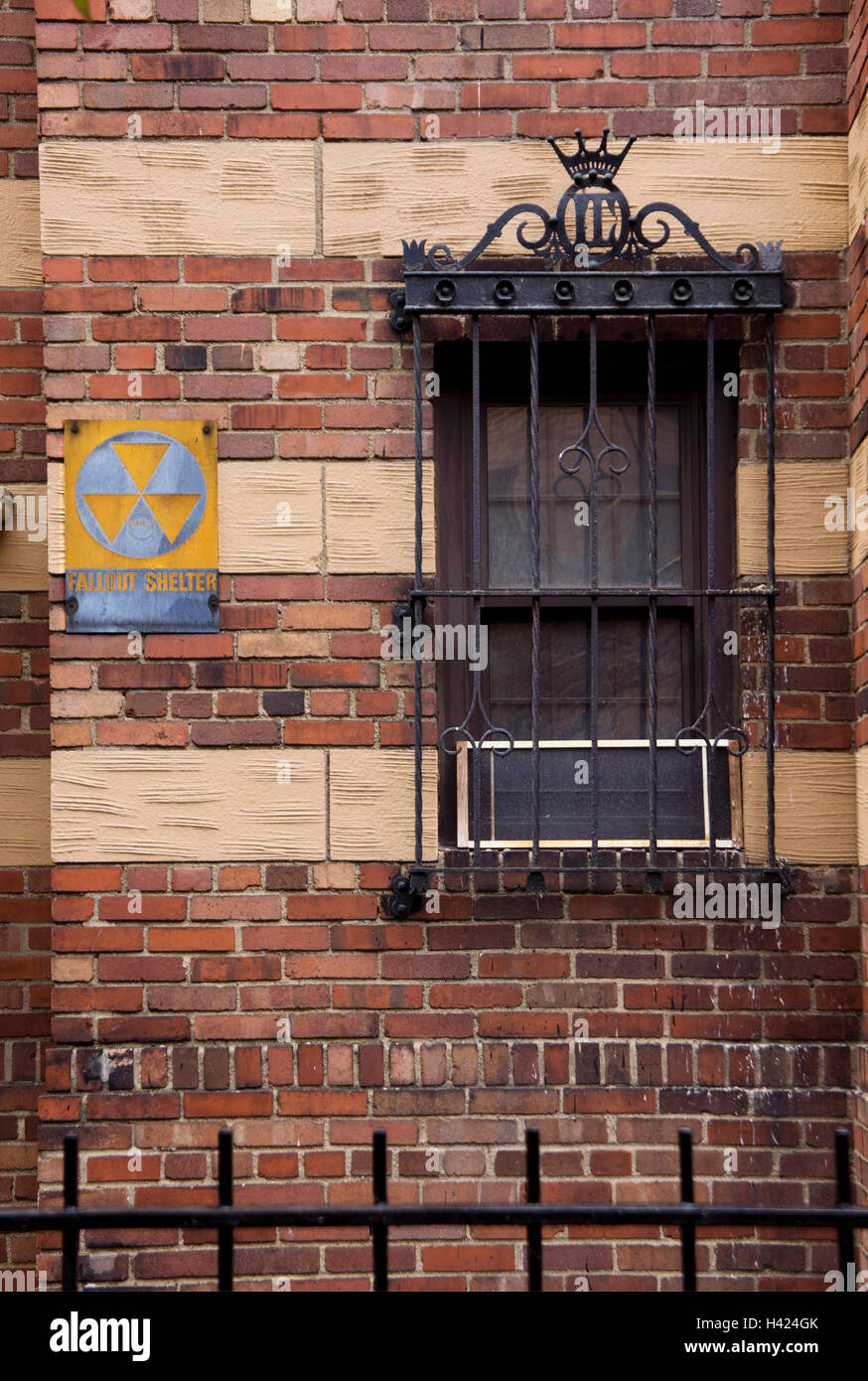 An ageing Fallout Shelter sign on an old building in Lower Manhattan, New York. Stock Photo
