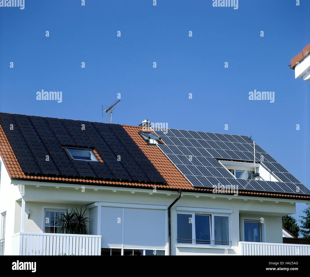 Germany, house roof, solar energy, solar panels on the left, solar cells on the right, house, residential house, - Stock Image