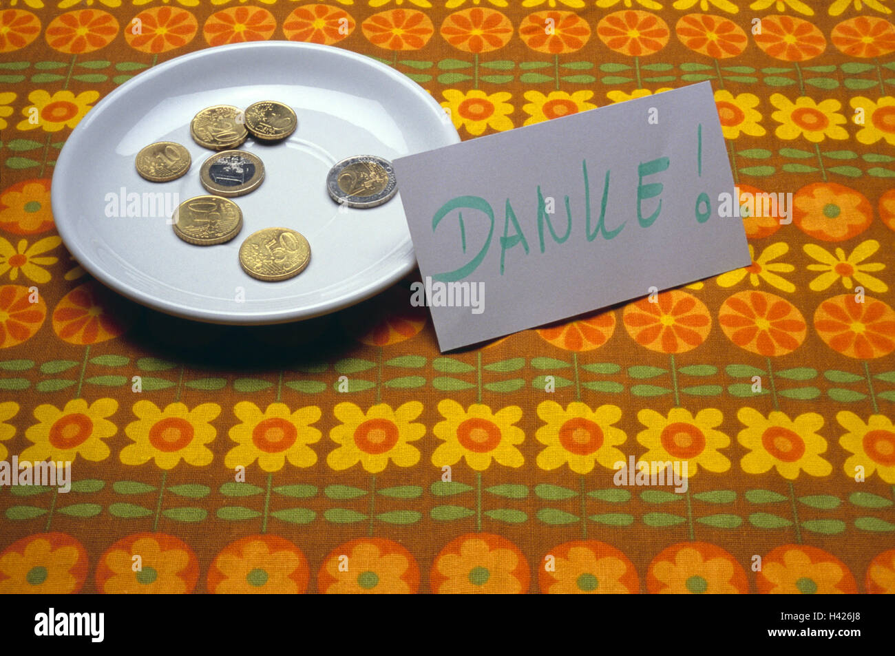 Plates, coins, tip, sign, stroke, thanks, , toilet, publicly, men's room, ladies' room, euro, euro coins, - Stock Image