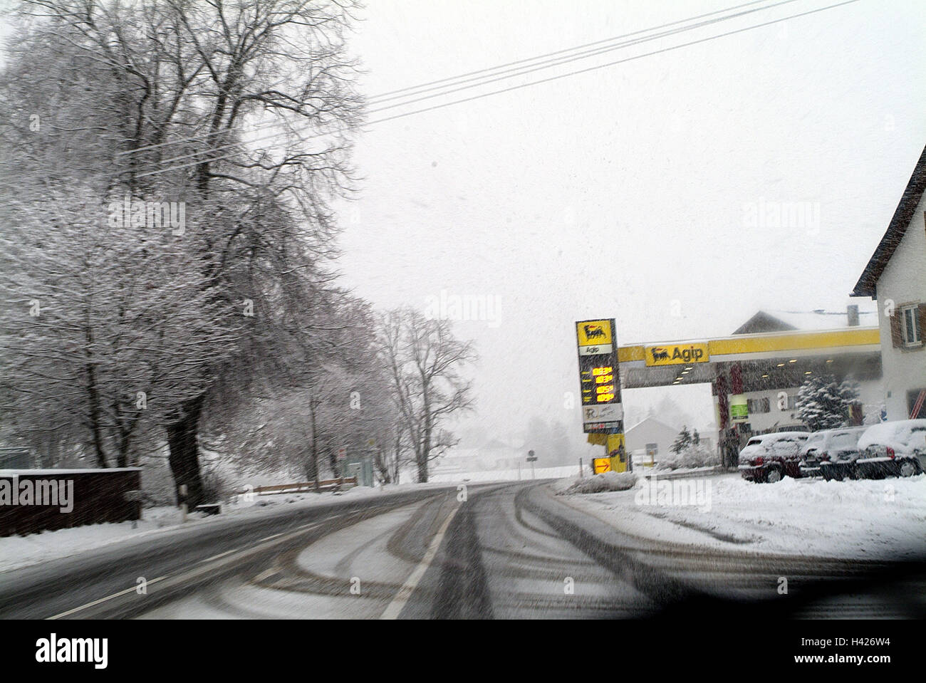 Place, junction, filling station, street relations, wintry, traffic facility, traffic route, traffic, street, traffic, - Stock Image