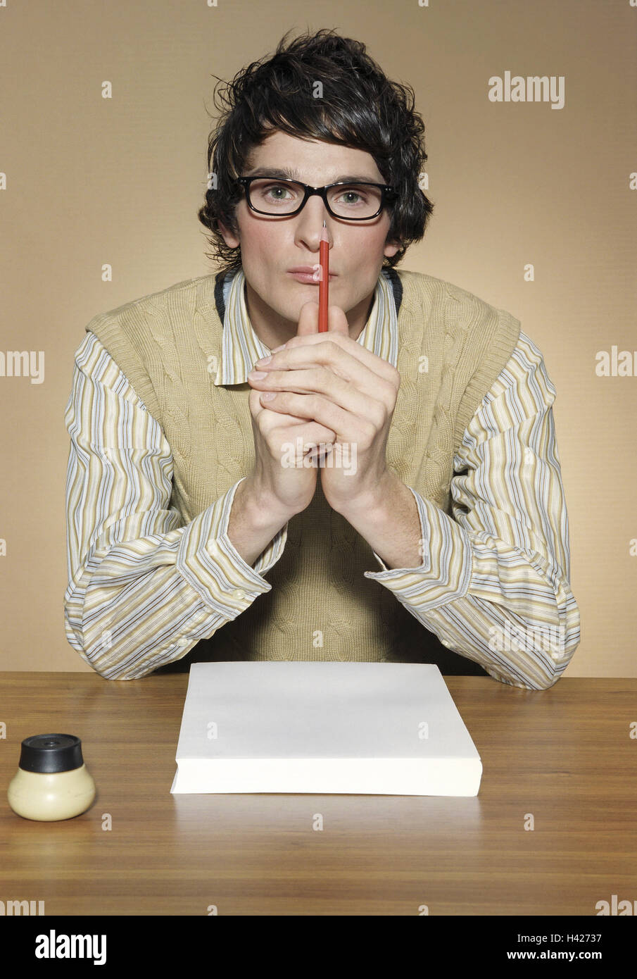 Desk, man, young, glasses,  Paper, pencil, gaze camera, portrait,,   Series, 20-30 years, dark-haired, shirt, Pullunder, Stock Photo