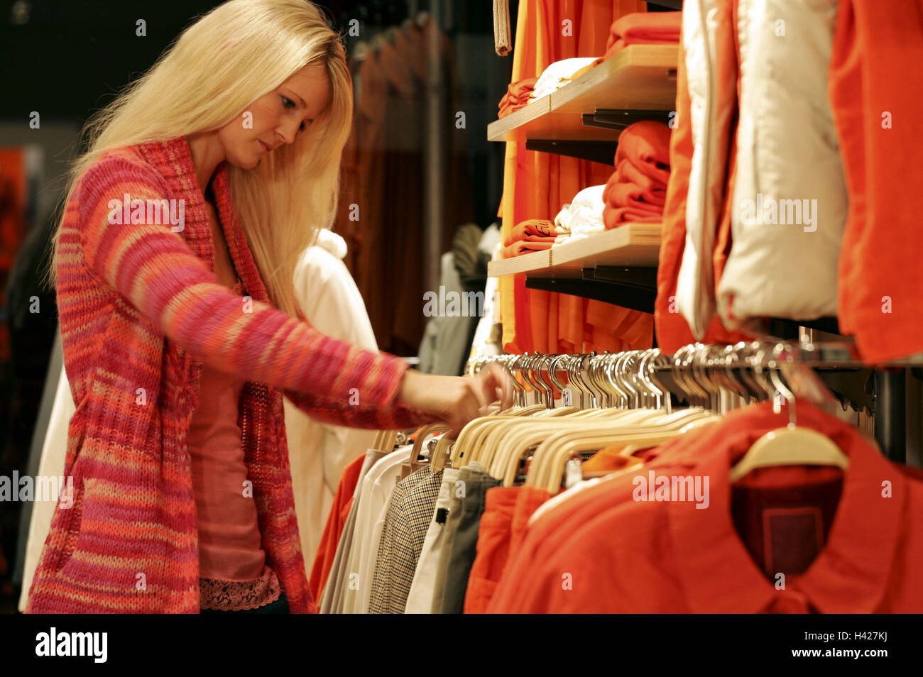 Woman, boutique, clothing, Shopping,  Selection, search,  Lifestyle, consumption, business, stores, shopping, purchase, - Stock Image