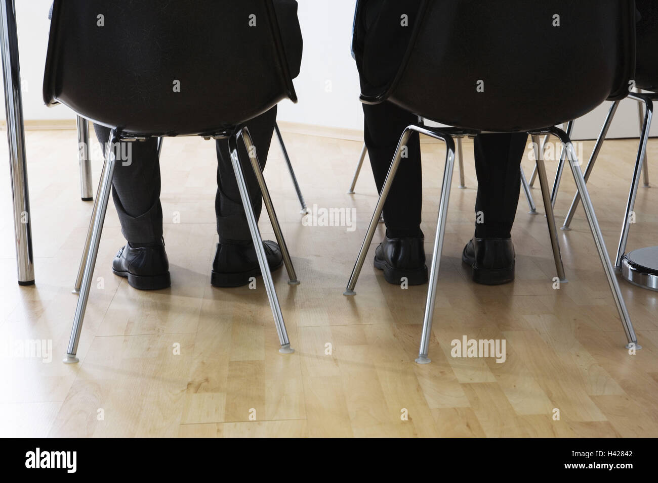 Men, detail, legs, chairs, sit,  Move opinion,   Participants business, office, attendant area, waiting rooms, application, - Stock Image