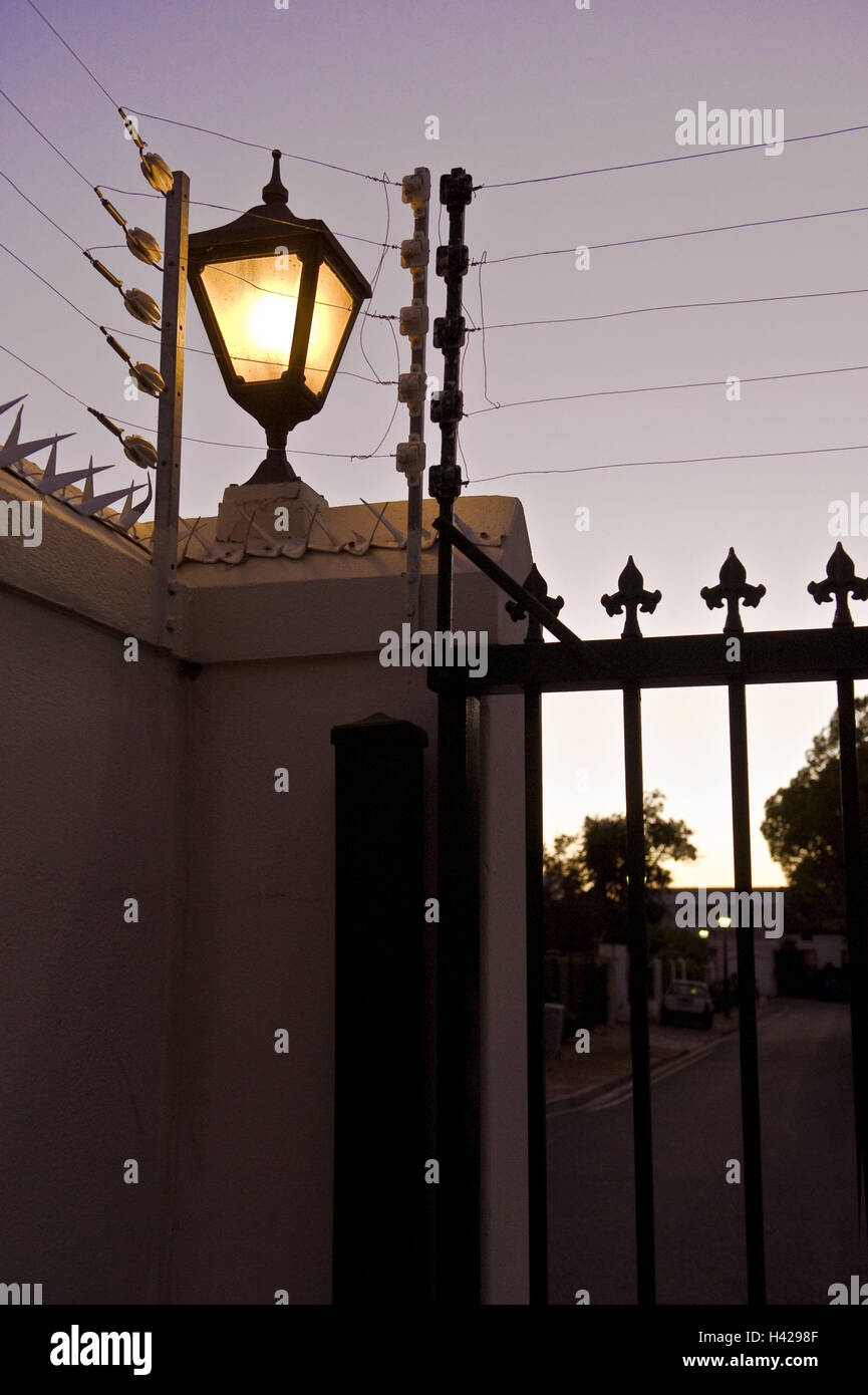 South africa western cape stellenbosch wall garden gate electric fence spikes lantern evening