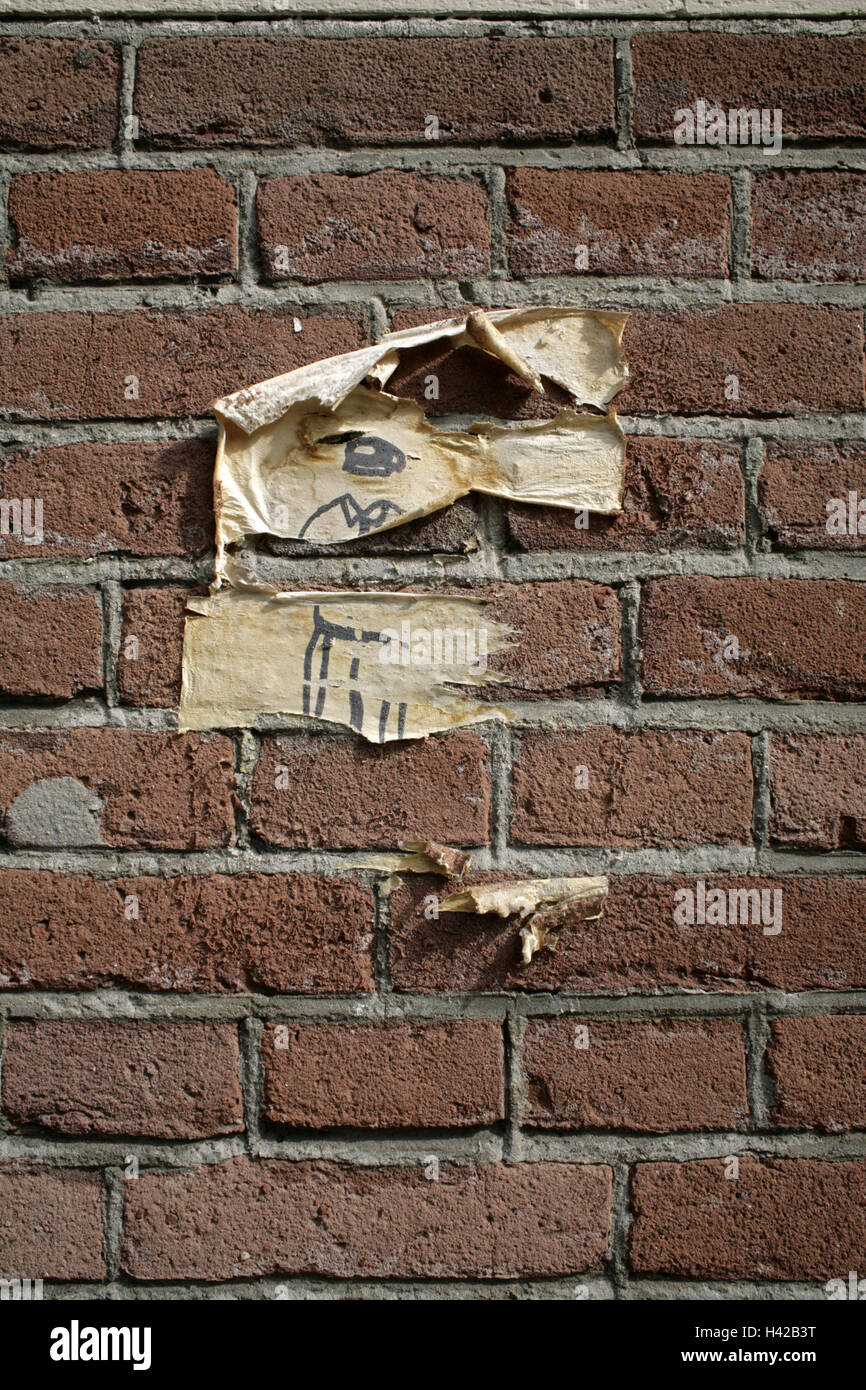 Brick wall, poster leftovers, - Stock Image