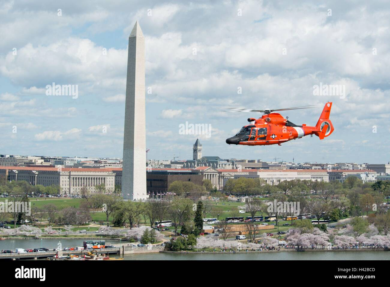 U S  Coast Guard helicopter crews fly over the Washington