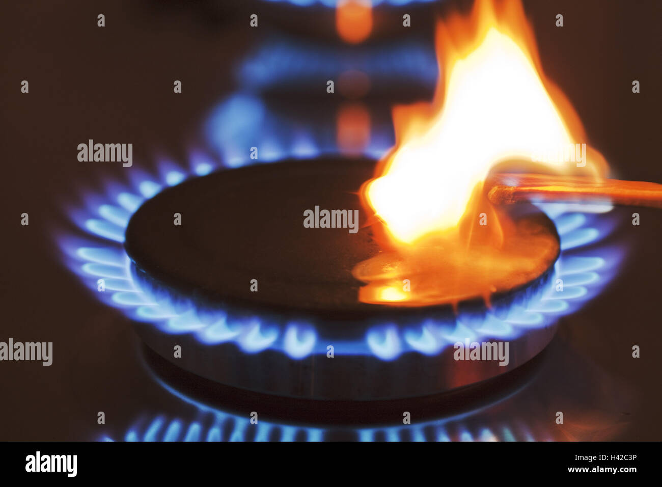 Match, gas flame, culinary focus, gas range, detail, - Stock Image