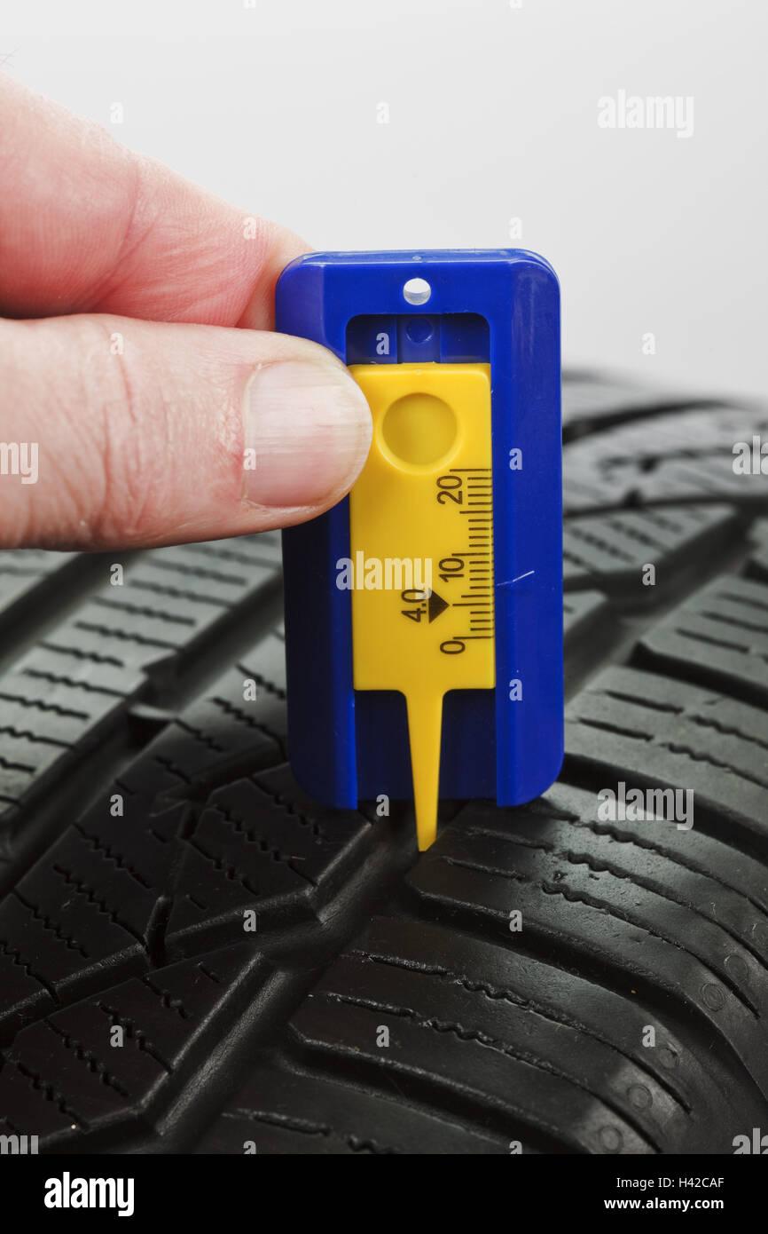 Controls, tread deepness, slide gauge, automobile tyre, - Stock Image