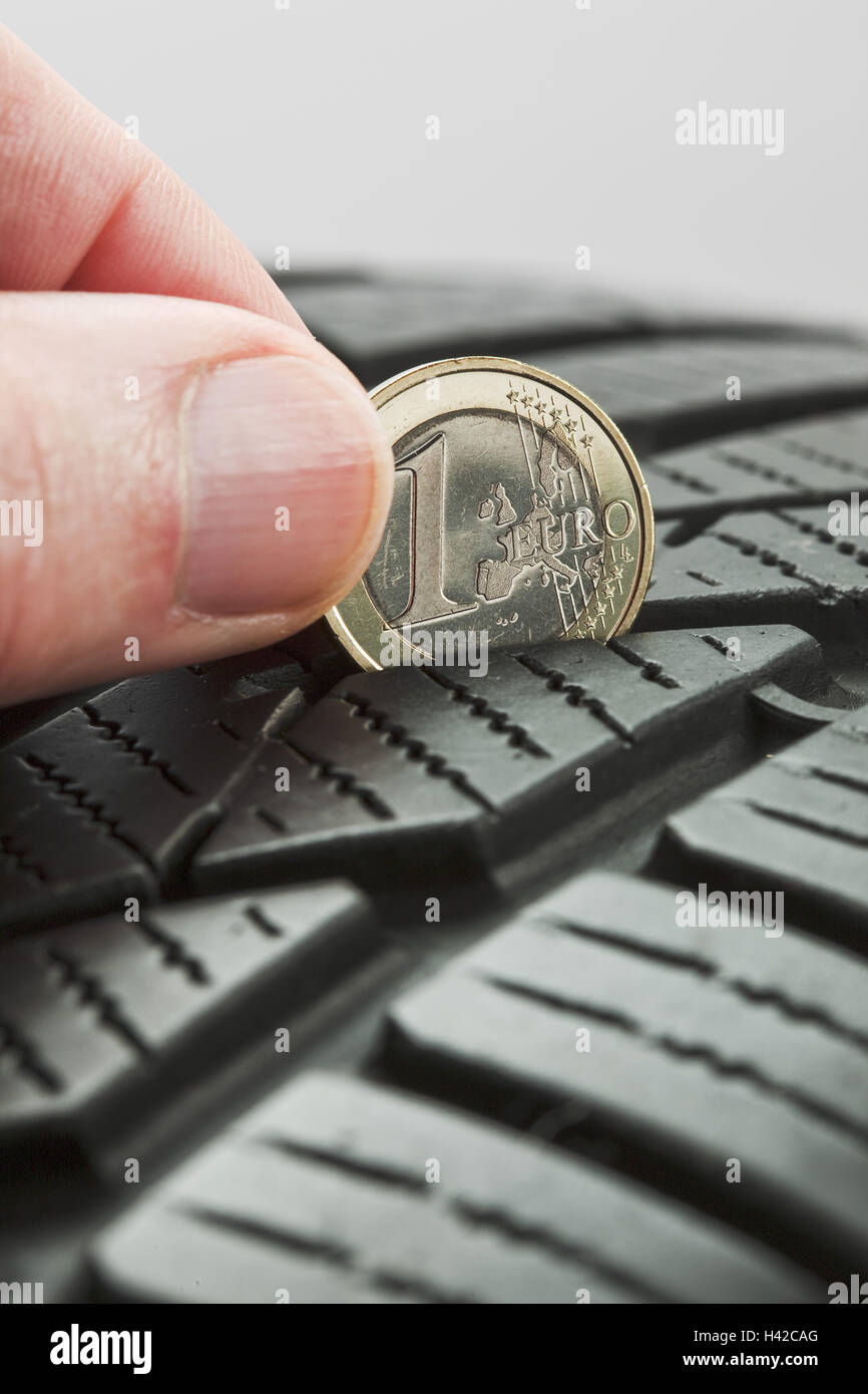 Controls, tread deepness, euro coin, automobile tyre, - Stock Image